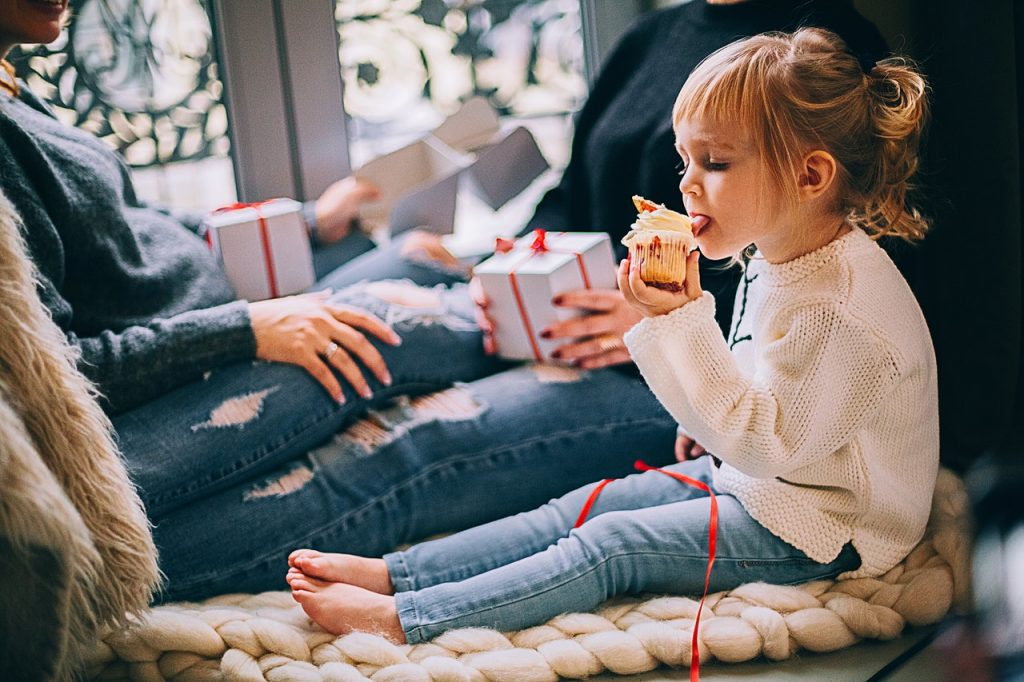 Girl licking a cupcake