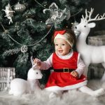 Baby by the Christmas Tree